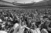 July 7, 1979: Fans arrived early to pack Dodger Stadium for a sell-out concert by the Bee Gees rock group. This photo was published in the July 8, 1979 Los Angeles Times.