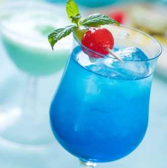 Blue cocktail with ice, selective focus