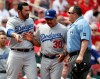 Los Angeles Dodgers' Adrian Gonzalez, left, is held back by manager Dave Roberts after being ejected by home plate umpire Marty Foster, right, during the ninth inning of a baseball game against the St. Louis Cardinals Thursday, June 1, 2017, in St. Louis. The Cardinals won 2-0. (AP Photo/Jeff Roberson) ORG XMIT: MOJR