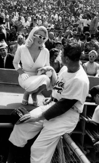 TV actress Juli Reding (L) talking with Dodger outfielder Valo Elmer (R).